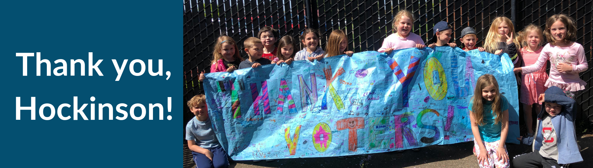"HHES students display a sign that says, ""Thank you, voters!"""